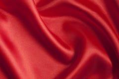 Fondo rojo liso del satén Imágenes de archivo libres de regalías