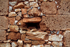 Fondo rojo o textura de la pared de piedra Imagen de archivo libre de regalías