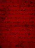 Fondo rojo oscuro profundo del Grunge con la escritura negra de la escritura Imágenes de archivo libres de regalías