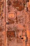 Fondo rojo oxidado de la puerta del metal Fotografía de archivo libre de regalías