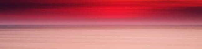 Fondo rojo pálido b de la leche del océano de la puesta del sol del panorama amplio horizontal Imagen de archivo libre de regalías