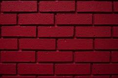 Fondo rojo sangre profundo de la pared de ladrillo del color imagen de archivo libre de regalías