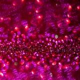 Fondo rojo y púrpura de la magia del brillo Luz Defocused y lugar enfocado libre para su diseño imagen de archivo