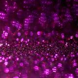 Fondo rojo y púrpura de la magia del brillo Luz Defocused y lugar enfocado libre para su diseño imagenes de archivo