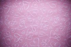 Fondo rosa del biglietto di S. Valentino dei cuori Fotografie Stock