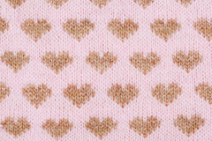Fondo rosa tricottato con i cuori dorati Fotografia Stock Libera da Diritti