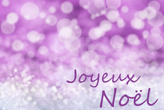 Fondo rosado de Bokeh, nieve, Joyeux Noel Means Merry Christmas Imagen de archivo libre de regalías