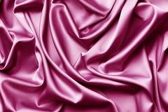 Fondo rosado de la textura de la seda o del sat fotos de archivo libres de regalías