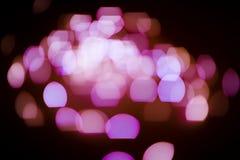 Fondo rosado de las luces del brillo defocused fotos de archivo