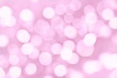 Fondo rosado del día de fiesta con las luces borrosas Imágenes de archivo libres de regalías