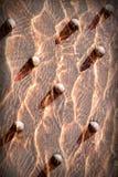 Fondo rosso astratto, metallo rivettato strutturato Fotografia Stock