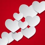 Fondo rosso con i cuori bianchi Fotografia Stock