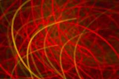 Fondo rosso con le linee curve luce Immagine Stock