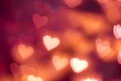 Fondo rosso di galleggiamento del bokeh di forma del cuore Fotografie Stock