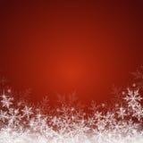 Fondo rosso di Natale con i fiocchi di neve Fotografie Stock