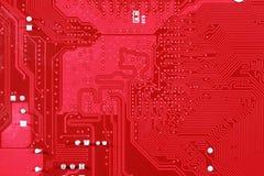 Fondo rosso di struttura del circuito della scheda madre del computer Fotografia Stock