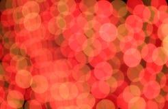 Fondo rosso ed arancio festivo con effetto del boke Immagini Stock Libere da Diritti
