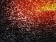 Fondo rosso ed arancione giallo nero astratto di pelle o di plastica elegante Fotografia Stock
