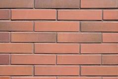 Fondo rosso senza cuciture del muro di mattoni Fotografia Stock