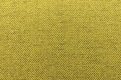 Fondo rugoso del oro de la materia textil Imágenes de archivo libres de regalías