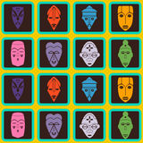 Fondo senza cuciture con le maschere rituali africane Fotografia Stock