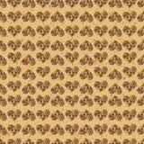 Fondo senza cuciture del modello Cuori di Brown su una terra dell'oro Carta da parati di tenerezza Immagini Stock