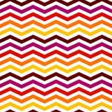 Fondo senza cuciture di Chevron con lo zigzag rosso, giallo, rosa e la o illustrazione di stock