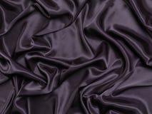Fondo serico brillante nero del tessuto Fotografie Stock Libere da Diritti