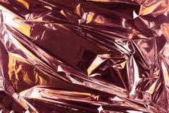Fondo sgualcito astratto della stagnola Fondo della foto di lerciume Oro di Rosa e colori arancio fotografia stock