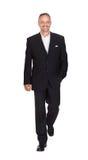 Fondo sonriente de Walking Over White del hombre de negocios imágenes de archivo libres de regalías