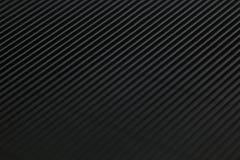 Fondo a strisce nero minimalistic astratto con le linee e l'intestazione diagonali Fotografia Stock