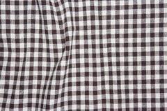 Fondo a strisce sgualcito di struttura del tessuto della tavola marrone Fotografia Stock