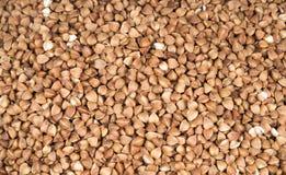 Fondo, struttura, la groppa buckwheat Grano saraceno arrostito Proprietà utili di grano saraceno Commercio nel settore agricolo,  fotografia stock