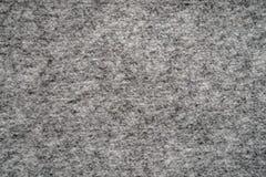 Fondo strutturato del tessuto grigio, modello astratto del tessuto della lana fotografia stock libera da diritti