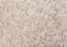 Fondo strutturato della parete ruvida beige Stucco di Abstact Struttura di gesso sulla parete Fotografia Stock
