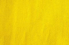 Fondo strutturato di tessuto giallo fotografia stock libera da diritti
