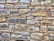 Fondo strutturato medievale della parete di pietra immagini stock
