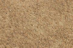 Fondo strutturato pietre delle piccole e della sporcizia fotografia stock