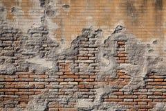 Fondo strutturato stagionato del muro di mattoni e del gesso Fotografie Stock