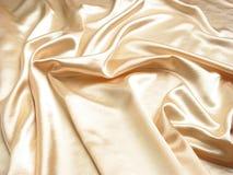 Fondo suave del satén del oro Imagen de archivo