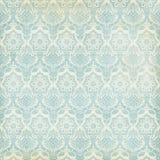 Fondo sucio del vintage azul y poner crema del damasco Foto de archivo libre de regalías