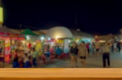 fondo superior de madera del mercado de la noche de la falta de definición de la tabla imágenes de archivo libres de regalías