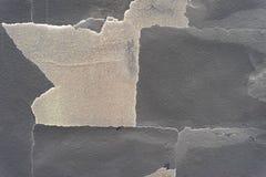 Fondo surrealista y dañado de la pared de piedra fotografía de archivo libre de regalías