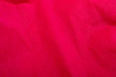 Fondo/textura rojos de la Navidad del papel de crepe Imagen de archivo