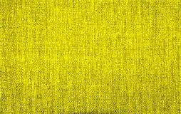Fondo texturizado de la materia textil natural amarilla imagenes de archivo