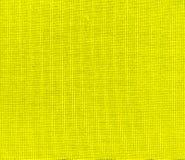 Fondo texturizado de la tela amarilla imágenes de archivo libres de regalías