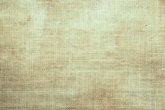 Fondo texturizado de la tela arrugada beige fotos de archivo