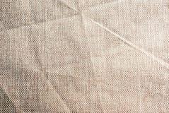 Fondo texturizado de la tela arrugada beige imagen de archivo libre de regalías