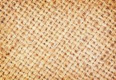Fondo texturizado marrón de la harpillera imagenes de archivo