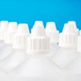 Fondo traslucido bianco delle bottiglie Fotografia Stock
